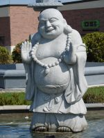 Laughing Buddha Stone Statue by FantasyStock