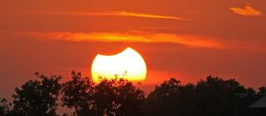 Partial Solar Eclipse Sundown (2 of 3) by Snowleopard59