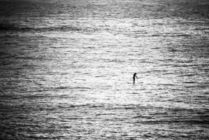Lonely Board Paddler by andyhutchinson