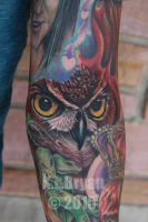 Owl face tattoo used as space filler for sleeve by danktat