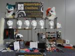 Our table at Anthrocon by DreamVisionCreations