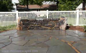 Flasgtone patio and wall with Fern/Spiral Inlay by Devine-Escapes