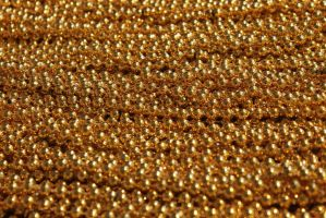 Gold Mardi Gras beads (stock) by QueenWerandra