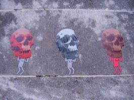 men with skulls wheatpasting by Uech