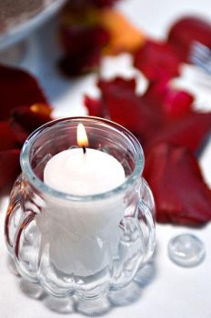 Candle and rose peddles by Ceardach