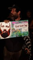 Sage Francis holding my painting of Sage Francis by Joshfryguy