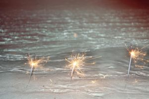 sparklers by the waves by puddingpolaroid