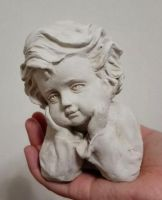 Clay sculpture of a child by sixzero1985