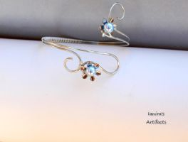 Wire upper arm bracelet with light blue Swarovski by IanirasArtifacts