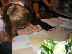 Me signing my diploma by mairdread