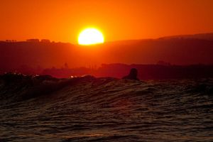 Paddling out at sunset by wildplaces