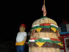 Fat Smittys Wooden Statues at Night by VoyagerHawk87