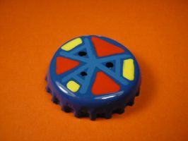 Blue, yellow, red and black badge. by elniniodelaschapas