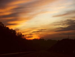 Driving at sunset by Catiiiii