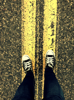 two lines of paint on asphalt and some converse by possim