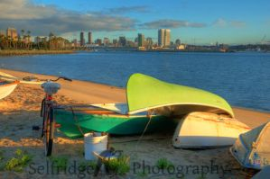 Green boat and a beach cruiser by spselfr