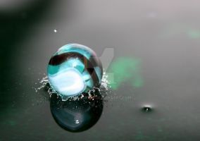 A marble falling into water by mimicry94