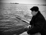 Just a man sitting near sea. by Argaeos
