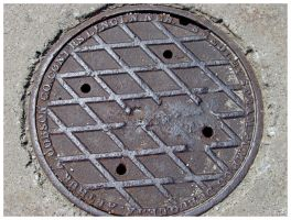 Worn Manhole Cover by jimwcolllins