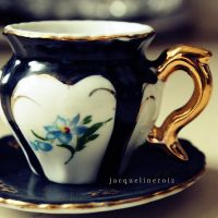 a teacup. by messofmemoriesxX