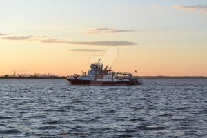NYFD on bay at sunset by ArtieWallace