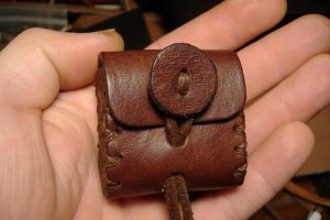 Tiny leather pouch by Wulfward
