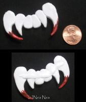 Vampire fangs charm by ElectricDinoSaur