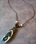 Norse Dragon Necklace by SalamenceClaws