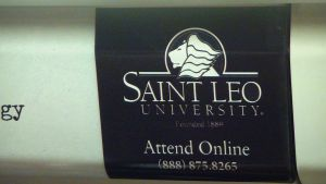 Saint Leo Advert on the DC subway by NamesAndSuch