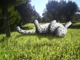 Snow leopard in green by SomethingWild7