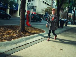Girl walking in red shoes by panfoto