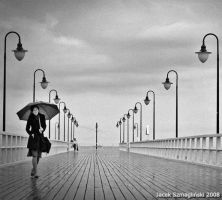 woman with umbrella by JSzmaglinski