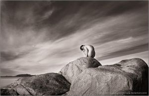 Sculpture on the cliff by lightandshape