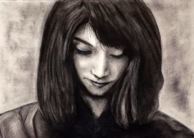 Charcoal practice 1 - downward looking woman by JesterOfTheLost