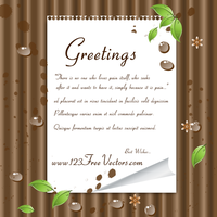 Green Leaves and Note Paper on Wooden Background by 123freevectors