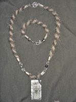 Arcticfox812 Snow Leopard and Wolf Jewelry Set by Wolf-of-Samhain
