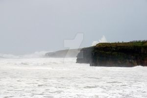 storm waves at Ballybunion cliffs by morrbyte