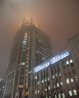 Tribune Tower in fog by spudart