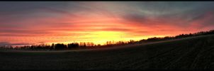 Sunset over a field by dn1w3r