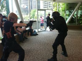 Leon and Umbrella Guard aiming at each other by Heero-Yuy01