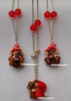 Necklace with slepping elf and coca-cola elves by Elfetta2007