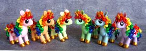 Rainbow Unicorns by DragonsAndBeasties