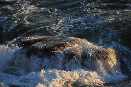 Wave Crashing over top a rock by RayMackenzie
