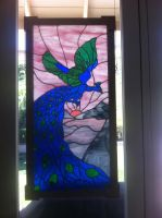 Peacock Window by littlemargay