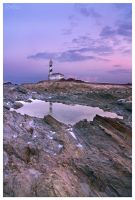 last light on the Favarix lighthouse by Climbotizzo