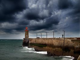 red lighthouse by VaggelisFragiadakis