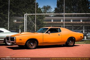 orange third gen charger by AmericanMuscle