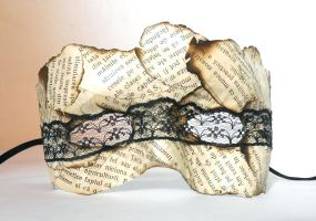 Mask of burnt book pages with lace over the eyes by dovespirit