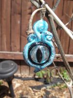Cheshire Cat eye pendant..INSPIRED! 2 by wittlecabbage