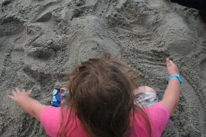 playing in the sand by Shamus360